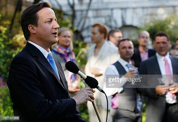 Britain's Prime Minister David Cameron addresses guests at the Gay Pride reception in the garden at 10 Downing Street in central London on June 16...