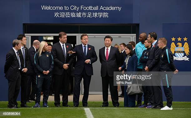 Britain's Prime Minister David Cameron and China's President Xi Jinping with Manchester City chairman Khaldoon Al Mubarak during a visit to the City...