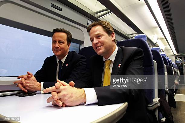 Britain's Prime Minister David Cameron and Deputy Prime Minister Nick Clegg ride a train to a cabinet meeting at the 2012 Olympic Games site on...