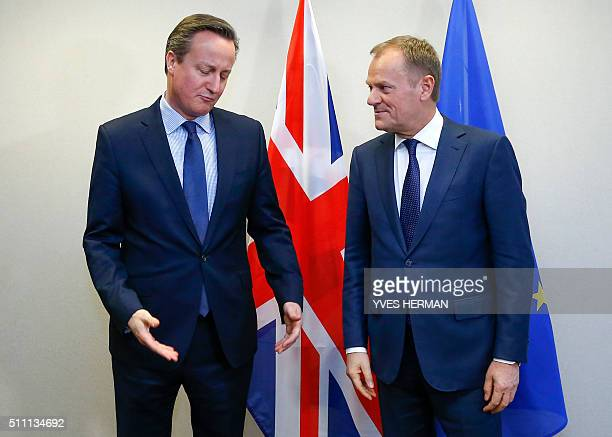Britain's Prime Minister David Cameron and European Council President Donald Tusk speak during a bilateral meeting ahead of an EU summit meeting at...