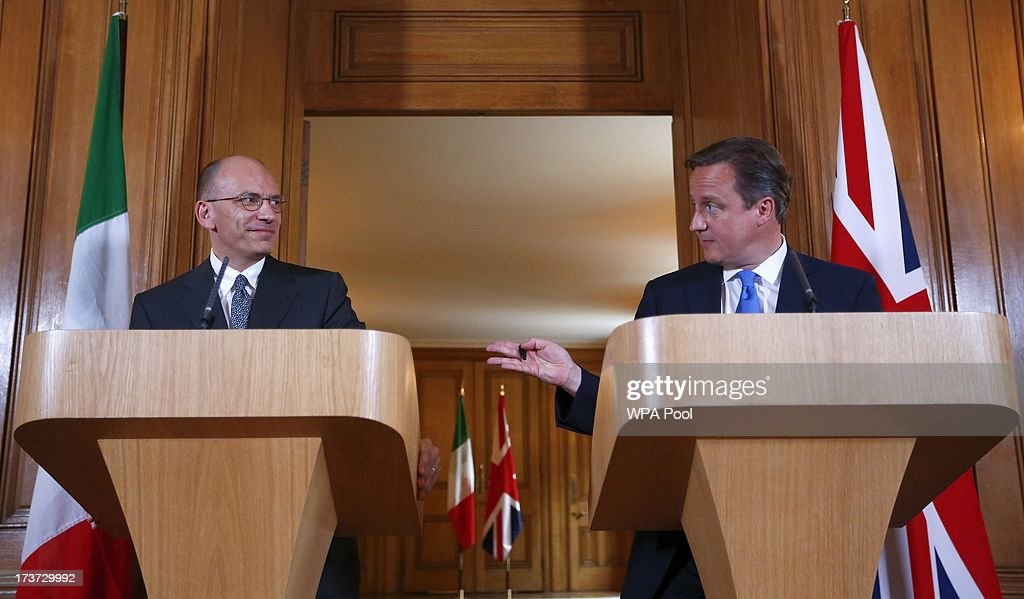 Britain's Prime Minister <a gi-track='captionPersonalityLinkClicked' href=/galleries/search?phrase=David+Cameron+-+Politician&family=editorial&specificpeople=227076 ng-click='$event.stopPropagation()'>David Cameron</a> (R) and his Italian counterpart <a gi-track='captionPersonalityLinkClicked' href=/galleries/search?phrase=Enrico+Letta&family=editorial&specificpeople=2915592 ng-click='$event.stopPropagation()'>Enrico Letta</a> hold a joint news conference in 10 Downing Street on July 17, 2013 in London, England. Mr Letta is here on a two-day visit and will later meet with Labour Party leader Ed Miliband at the Italian Embassy in London.