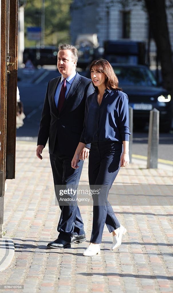Britain's Prime Minister, David Cameron (L) and his wife Samantha (R) arrive the Central Methodist Hall polling station to cast their votes for the London Mayoral Elections in London, England on May 05, 2016. Elections are taking place for the Scottish Parliament, National Assembly of Wales, the Northern Ireland Assembly, the London Mayor and for 124 councils in England. .