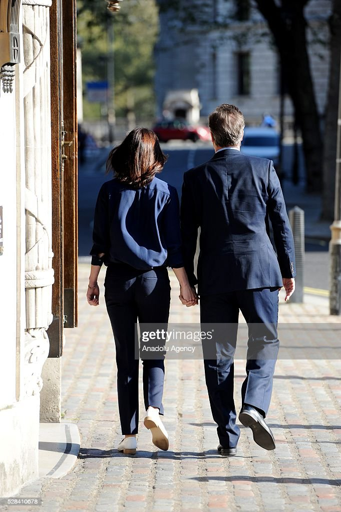 Britain's Prime Minister, David Cameron (R) and his wife Samantha (L) leave the Central Methodist Hall polling station after they cast their votes for the London Mayoral Elections in London, England on May 05, 2016. Elections are taking place for the Scottish Parliament, National Assembly of Wales, the Northern Ireland Assembly, the London Mayor and for 124 councils in England. .