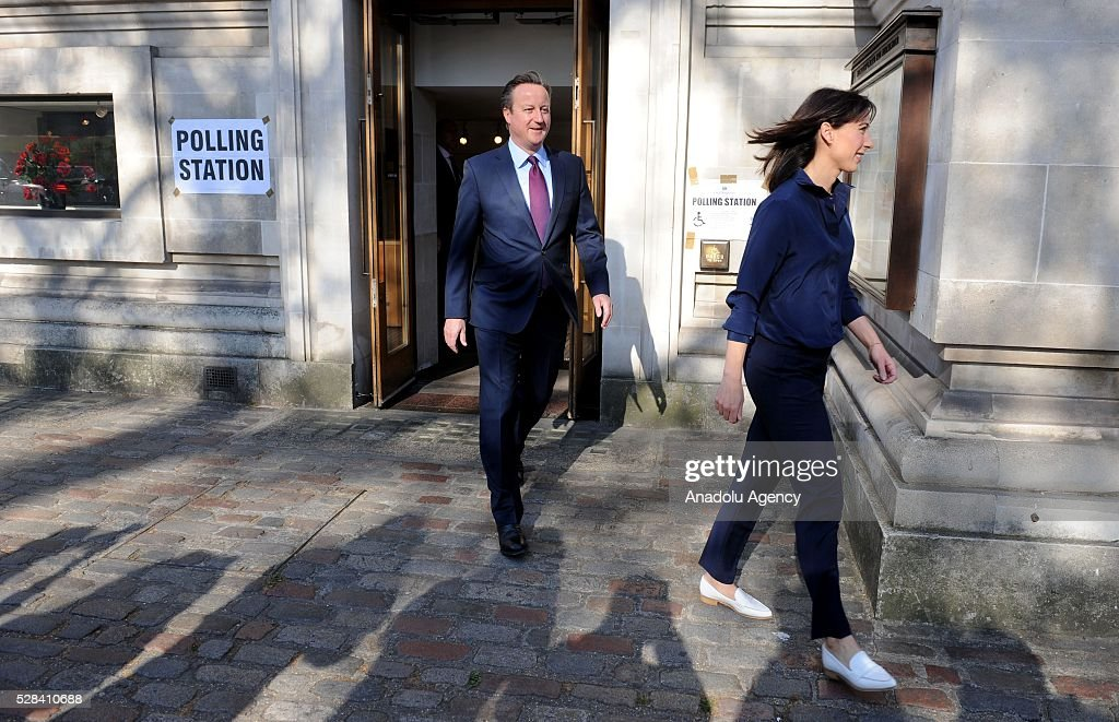 Britain's Prime Minister, David Cameron (L) and his wife Samantha (R) leave the Central Methodist Hall polling station after they cast their votes for the London Mayoral Elections in London, England on May 05, 2016. Elections are taking place for the Scottish Parliament, National Assembly of Wales, the Northern Ireland Assembly, the London Mayor and for 124 councils in England. .