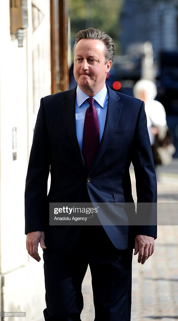 Britain's Prime Minister, David Cameron (C) and his wife Samantha (not seen) leave the Central Methodist Hall polling station after they cast their votes for the London Mayoral Elections in London, England on May 05, 2016. Elections are taking place for the Scottish Parliament, National Assembly of Wales, the Northern Ireland Assembly, the London Mayor and for 124 councils in England. .