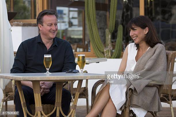 Britain's Prime Minister David Cameron and his wife Samantha pose for a photograph during their holiday on March 25 2016 in Playa Blanca Lanzarote...