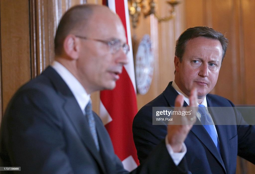 Britain's Prime Minister <a gi-track='captionPersonalityLinkClicked' href=/galleries/search?phrase=David+Cameron+-+Politician&family=editorial&specificpeople=227076 ng-click='$event.stopPropagation()'>David Cameron</a> (R) and Italy's Prime Minister <a gi-track='captionPersonalityLinkClicked' href=/galleries/search?phrase=Enrico+Letta&family=editorial&specificpeople=2915592 ng-click='$event.stopPropagation()'>Enrico Letta</a> hold a joint news conference in 10 Downing Street on July 17, 2013 in London, England. Mr Letta is here on a two-day visit and will later meet with Labour Party leader Ed Miliband at the Italian Embassy in London.