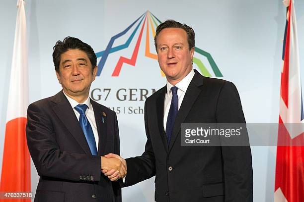 Britain's Prime Minister David Cameron and Japan's Prime Minister Shinzo Abe attend a bilateral meeting at the summit of G7 nations at Schloss Elmau...