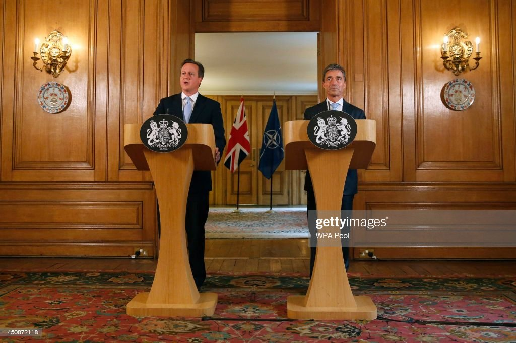 Britain's Prime Minister <a gi-track='captionPersonalityLinkClicked' href=/galleries/search?phrase=David+Cameron+-+Politicus&family=editorial&specificpeople=227076 ng-click='$event.stopPropagation()'>David Cameron</a> (L) and NATO Secretary-General <a gi-track='captionPersonalityLinkClicked' href=/galleries/search?phrase=Anders+Fogh+Rasmussen&family=editorial&specificpeople=549374 ng-click='$event.stopPropagation()'>Anders Fogh Rasmussen</a> hold a joint news conference in Downing Street on June 19, 2014 in London, England. During his visit to the United Kingdom the Secretary General will meet with British Prime Minister <a gi-track='captionPersonalityLinkClicked' href=/galleries/search?phrase=David+Cameron+-+Politicus&family=editorial&specificpeople=227076 ng-click='$event.stopPropagation()'>David Cameron</a>, British Foreign Secretary William Hague and British Defence Secretary Philip Hammond in preparation for the 2014 NATO Summit in Wales.