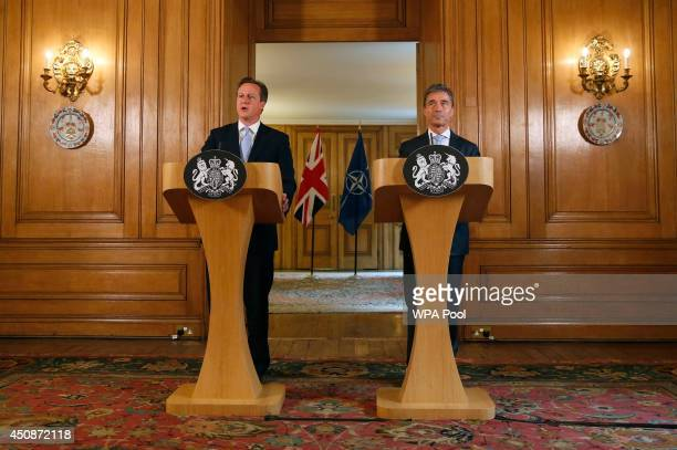Britain's Prime Minister David Cameron and NATO SecretaryGeneral Anders Fogh Rasmussen hold a joint news conference in Downing Street on June 19 2014...