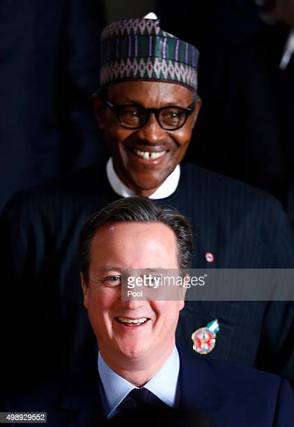 Britain's Prime Minister David Cameron and Nigeria's President Muhammadu Buhari pose for a group photograph at CHOGM opening ceremony at the...