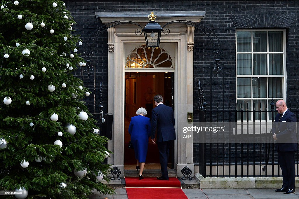 Britain's Prime Minister David Cameron (R) and Queen Elizabeth II (L) enter No 10 Downing Street in London December 18, 2012 as she arrives to attend a meeting of the Cabinet. Queen Elizabeth II attended her first-ever cabinet meeting on Tuesday to mark her diamond jubilee, the only monarch to do so since 1781.The 86-year-old sovereign sat in as an observer on the meeting and received a gift from the Cabinet to celebrate her 60 years on the throne. AFP PHOTO / BEN STANSALL