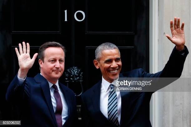 Britain's Prime Minister David Cameron and US President Barack Obama wave outside the door to 10 Downing Street ahead of talks in central London on...