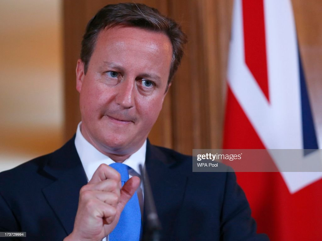 Britain's Prime Minister <a gi-track='captionPersonalityLinkClicked' href=/galleries/search?phrase=David+Cameron+-+Politician&family=editorial&specificpeople=227076 ng-click='$event.stopPropagation()'>David Cameron</a> answers a question during a joint news conference with Italy's Prime Minister Enrico Letta in 10 Downing Street on July 17, 2013 in London, England. Mr Letta is here on a two-day visit and will later meet with Labour Party leader Ed Miliband at the Italian Embassy in London.