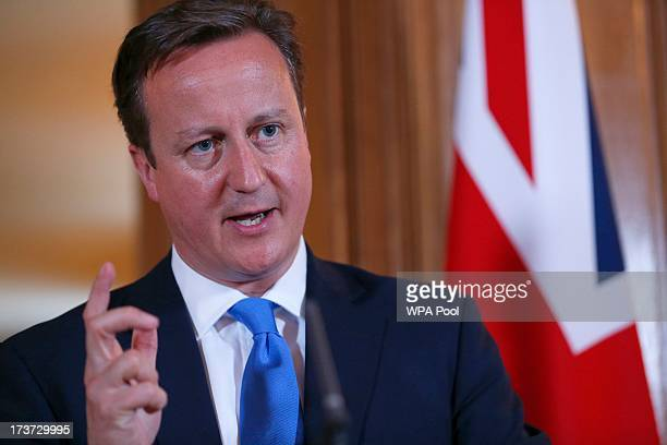 Britain's Prime Minister David Cameron answers a question during a joint news conference with Italy's Prime Minister Enrico Letta in 10 Downing...