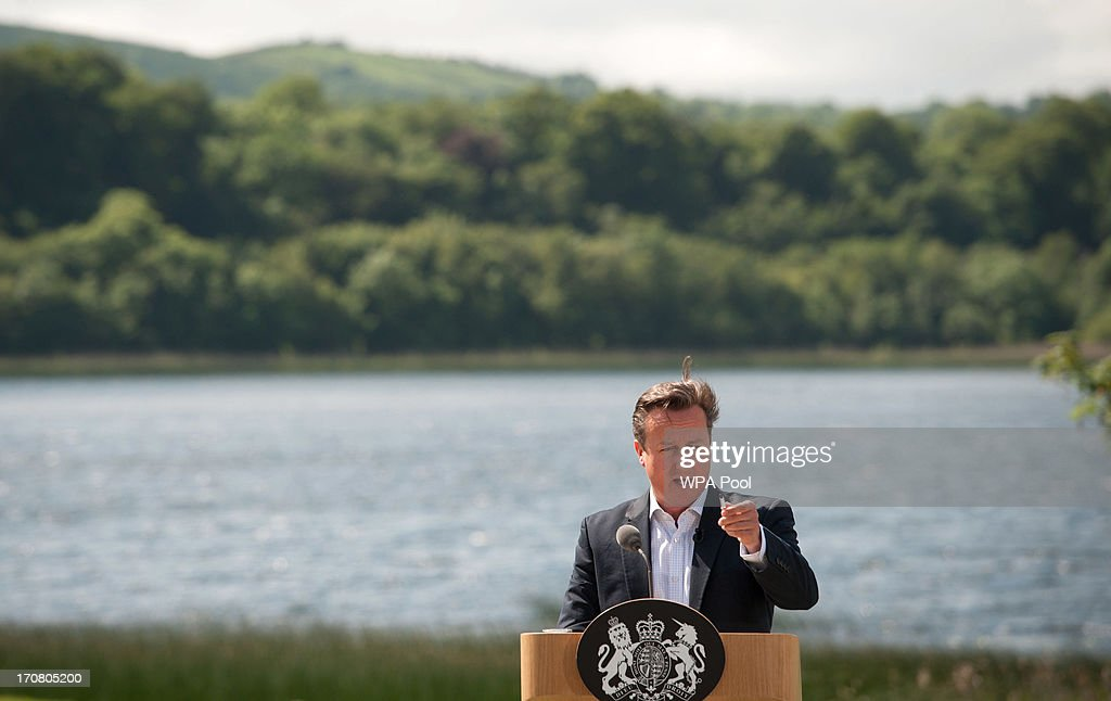 Britain's Prime Minister David Cameron, answers questions from the media at a concluding press conference at the G8 venue of Lough Erne on June 18, 2013 in Enniskillen, Northern Ireland. The two day G8 summit, hosted by UK Prime Minister David Cameron, is being held in Northern Ireland for the first time. Leaders from the G8 nations have gathered to discuss numerous topics with the situation in Syria expected to dominate the talks.