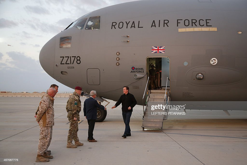 Britain's Prime Minister David Cameron arrives at Camp Bastion outside Lashkar Gah the provincial capital of Helmand province in southern Afghanistan...
