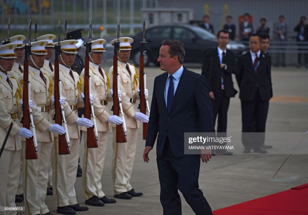 Britain's Prime Minister David Cameron (C) arrives at Chubu Centrair International Airport in Nagoya on May 25, 2016 ahead of the 2016 Ise-Shima G7 Summit. World leaders began gathering in Japan on May 25 ahead of a Group of Seven summit set to be dominated by the lacklustre global economy. / AFP / MANAN