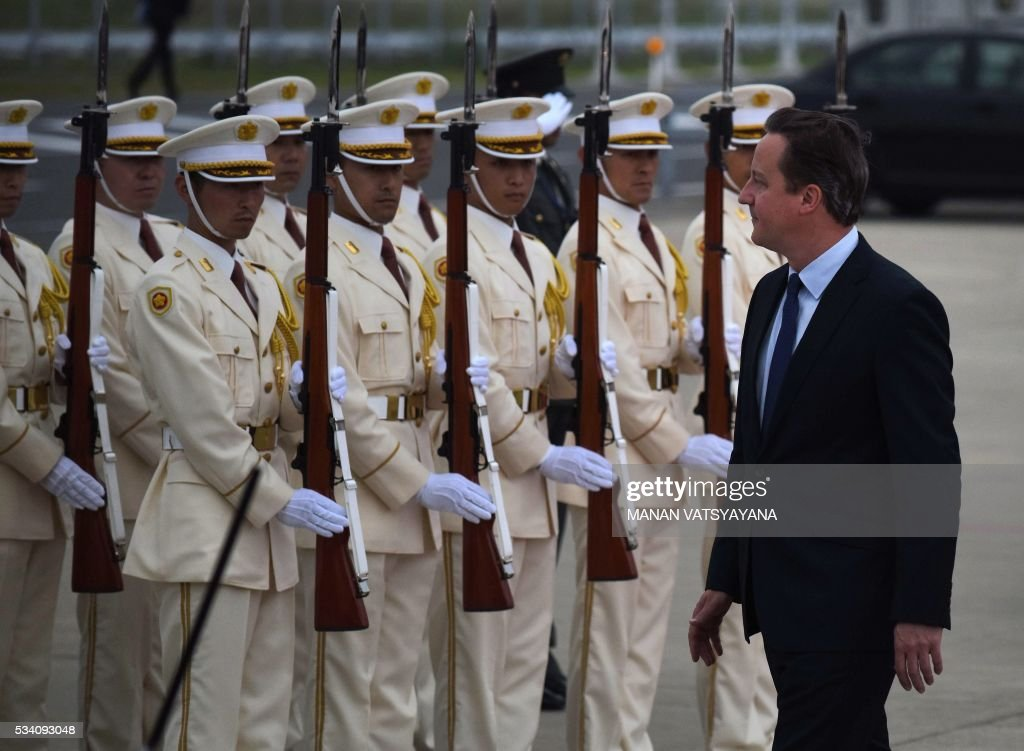 Britain's Prime Minister David Cameron (R) arrives at Chubu Centrair International Airport in Nagoya on May 25, 2016 ahead of the 2016 Ise-Shima G7 Summit. World leaders began gathering in Japan on May 25 ahead of a Group of Seven summit set to be dominated by the lacklustre global economy. / AFP / MANAN