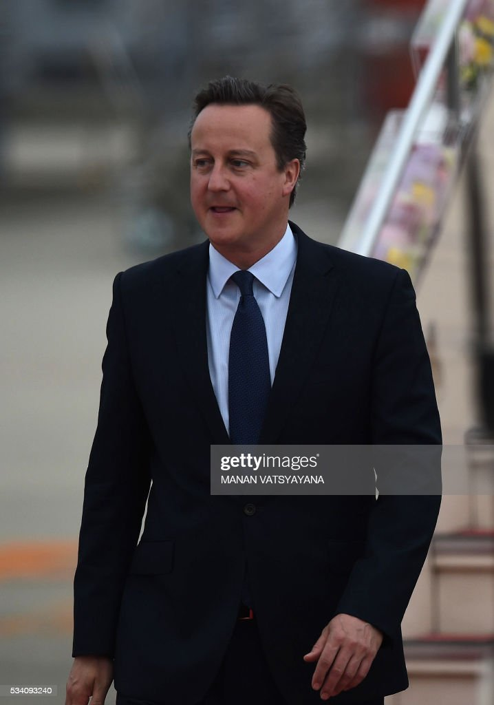 Britain's Prime Minister David Cameron arrives at Chubu Centrair International Airport in Nagoya on May 25, 2016 ahead of the 2016 Ise-Shima G7 Summit. World leaders began gathering in Japan on May 25 ahead of a Group of Seven summit set to be dominated by the lacklustre global economy. / AFP / MANAN
