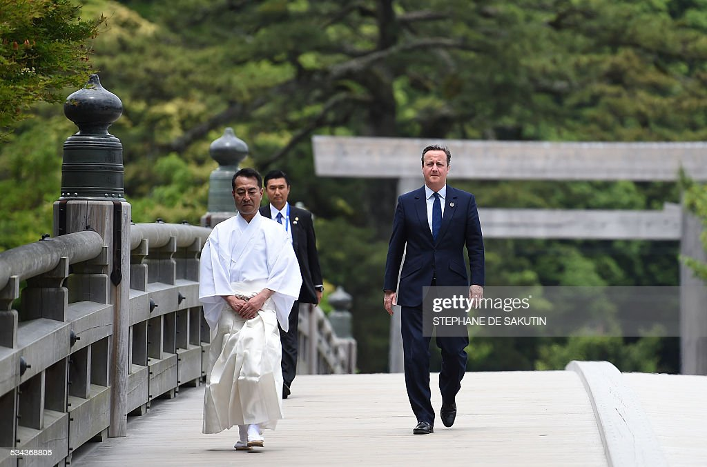 Britain's Prime Minister David Cameron arrives at Ise-Jingu Shrine in the city of Ise in Mie prefecture, on May 26, 2016, on the first day of the G7 leaders summit. World leaders kick off two days of G7 talks in Japan on May 26 with the creaky global economy, terrorism, refugees, China's controversial maritime claims, and a possible Brexit headlining their packed agenda. / AFP / STEPHANE
