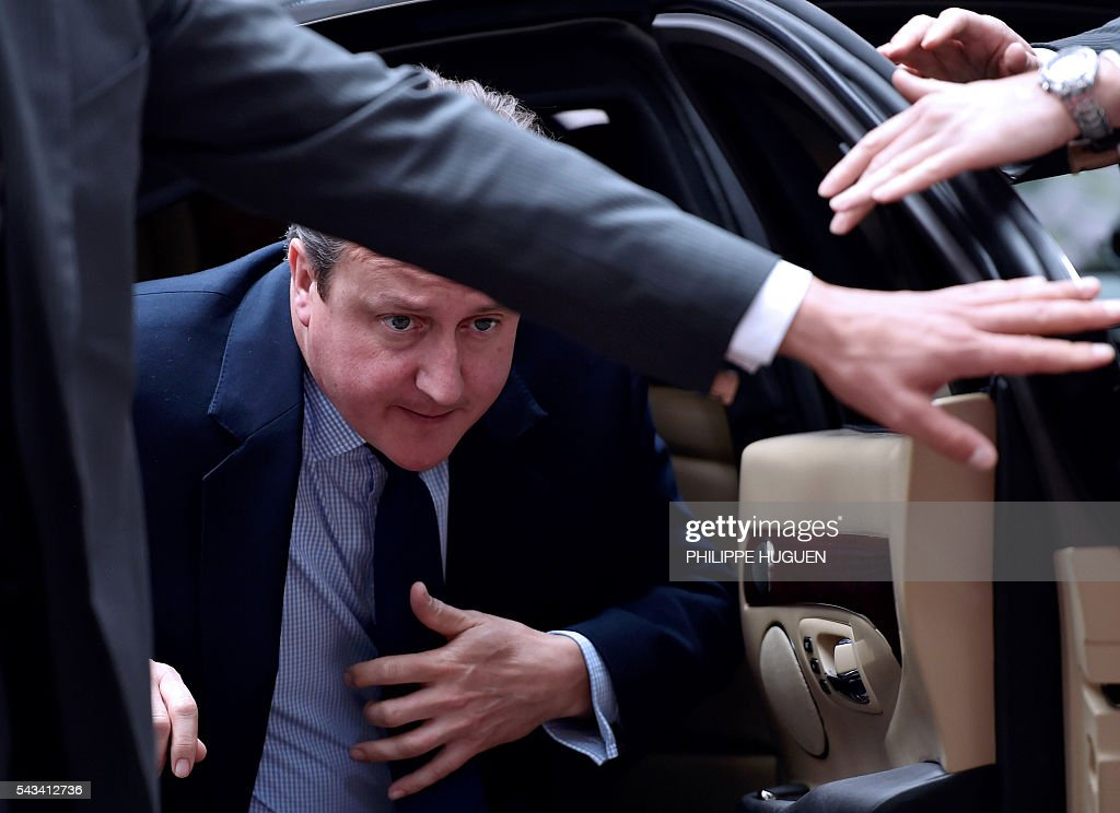 TOPSHOT - Britain's Prime minister David Cameron arrives before an EU summit meeting on June 28, 2016 at the European Union headquarters in Brussels. / AFP / PHILIPPE