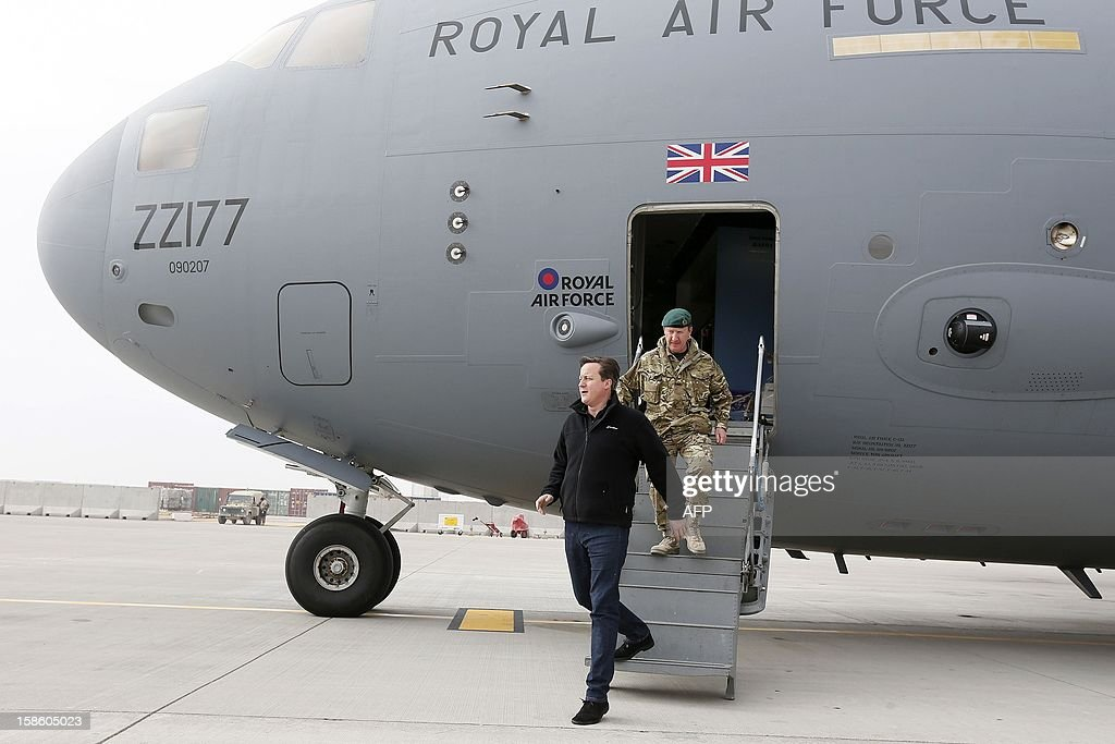 Britain's Prime Minister David Cameron arrives for a visit to Camp Bastion, outside Lashkar Gah in Helmand Province, Afghanistan on December 20, 2012. British Prime Minister David Cameron on December 19, 2012 said that he will withdraw almost half of the country's 9,000 troops from Afghanistan next year as NATO hands over to Afghan forces. AFP PHOTO/POOL/ Stefan Wermuth