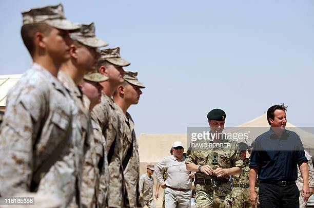 Britain's Prime Minister David Cameron arrives to give a July 4th address to British and American troops at the Camp Leatherneck military base in...