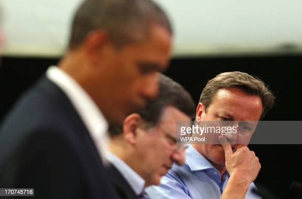 Britain's Prime Minister David Cameron attends a news conference with US President Barack Obama European commission president Jose Manuel Barroso and...