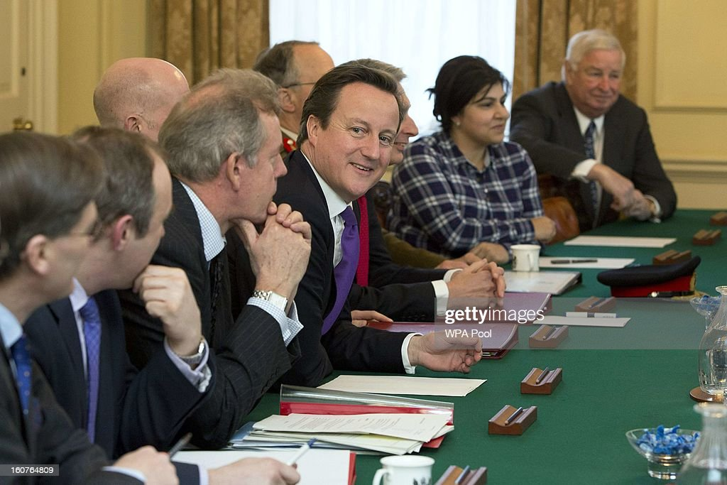 Britain's Prime Minister <a gi-track='captionPersonalityLinkClicked' href=/galleries/search?phrase=David+Cameron+-+Politician&family=editorial&specificpeople=227076 ng-click='$event.stopPropagation()'>David Cameron</a> (C) chairs a security briefing attended by U.S. Vice President Joe Biden (unseen) at Number 10 Downing Street on February 5, 2013 in London, England. Mr Biden met with Deputy Prime Minister Nick Clegg and Prime Minister <a gi-track='captionPersonalityLinkClicked' href=/galleries/search?phrase=David+Cameron+-+Politician&family=editorial&specificpeople=227076 ng-click='$event.stopPropagation()'>David Cameron</a> during his visit to the UK, as part of a wider European tour.