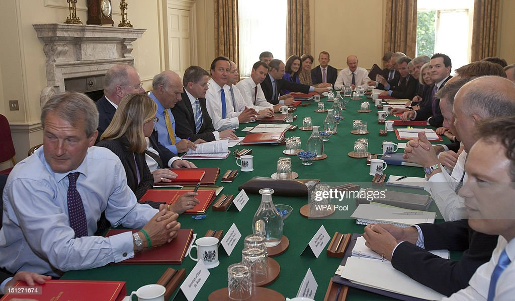 Britain's Prime Minister <a gi-track='captionPersonalityLinkClicked' href=/galleries/search?phrase=David+Cameron+-+Politician&family=editorial&specificpeople=227076 ng-click='$event.stopPropagation()'>David Cameron</a> chairs the first cabinet meeting following a ministerial re-shuffle, with (L-R) Environment Secretary Owen Paterson, International Development Secretary Justine Greening, Communities Secretary Eric Pickles, Business Secretary <a gi-track='captionPersonalityLinkClicked' href=/galleries/search?phrase=Vince+Cable&family=editorial&specificpeople=4872939 ng-click='$event.stopPropagation()'>Vince Cable</a>, Cabinet Secretary Jeremy Heywood, Prime Minister <a gi-track='captionPersonalityLinkClicked' href=/galleries/search?phrase=David+Cameron+-+Politician&family=editorial&specificpeople=227076 ng-click='$event.stopPropagation()'>David Cameron</a>, Foreign Secretary <a gi-track='captionPersonalityLinkClicked' href=/galleries/search?phrase=William+Hague&family=editorial&specificpeople=206295 ng-click='$event.stopPropagation()'>William Hague</a>, Health Secretary Jeremy Hunt, Energy Secretary Edward Davey, (obscured), Northern Ireland Secretary Theresa Villiers, Culture Secretary Maria Miller, education minister <a gi-track='captionPersonalityLinkClicked' href=/galleries/search?phrase=David+Laws&family=editorial&specificpeople=1147113 ng-click='$event.stopPropagation()'>David Laws</a>, universities minister David Willetts, Leader of the House of Lords Thomas Strathclyde, (obscured), Minister of State at the Cabinet Office, Oliver Letwin, Chief Whip Andrew Mitchell, Leader of the House Andrew Lansley, Home Secretary Theresa May, Chancellor of the Exchequer George Osborne, Deputy Prime Minister <a gi-track='captionPersonalityLinkClicked' href=/galleries/search?phrase=Nick+Clegg&family=editorial&specificpeople=579276 ng-click='$event.stopPropagation()'>Nick Clegg</a> (hidden), Chief Secretary to the Treasury Danny Alexander (hidden), Education Secretary Michael Gove, Justice Secretary Christopher Grayling, Conservative Party chairman Grant Shapps, in Downing Street on September 5, 2012 in London, England. The Prime Minsiter had to defend his choices over his new cabinet in the House of Commons today at the weekly Prime Minister's Questions. (Photo by Neil Hall - WPA Pool/Getty Images)s)