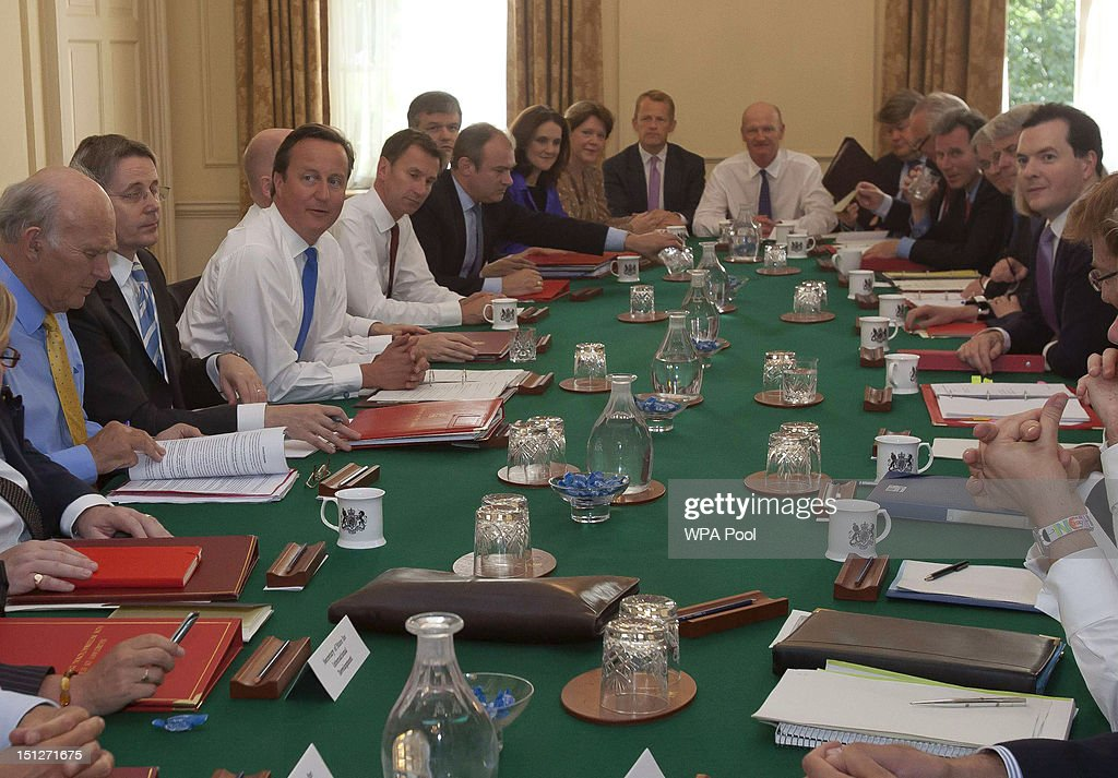 Britain's Prime Minister <a gi-track='captionPersonalityLinkClicked' href=/galleries/search?phrase=David+Cameron+-+Politician&family=editorial&specificpeople=227076 ng-click='$event.stopPropagation()'>David Cameron</a> (6L) chairs the first cabinet meeting following a ministerial re-shuffle, in Downing Street on September 5, 2012 in London, England. The Prime Minsiter had to defend his choices over his new cabinet in the House of Commons today at the weekly Prime Minister's Questions.