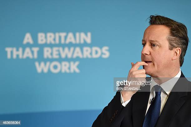 Britain's Prime Minister David Cameron delivers a speech on welfare in Hove East Sussex on February 17 2015 AFP PHOTO / BEN STANSALL
