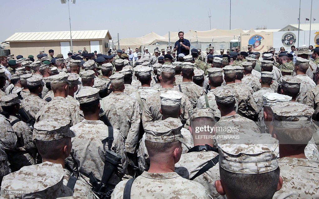Britain's Prime Minister David Cameron delivers a speech to British and US troops during a visit to Camp Bastion outside Lashkar Gah the provincial...