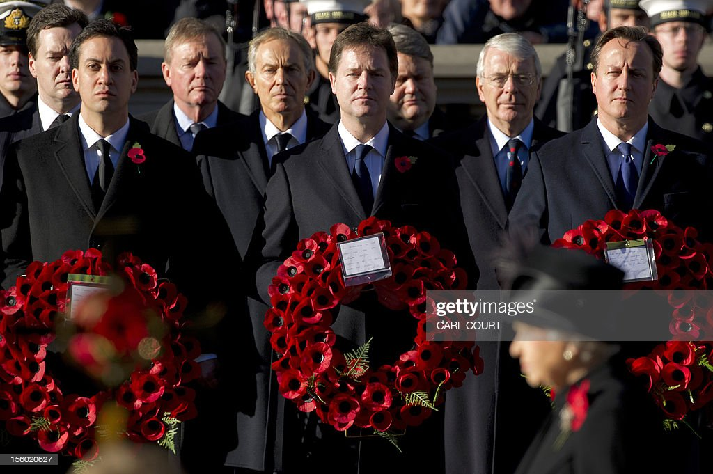 Britain's Prime Minister David Cameron (Front-R), Deputy Prime Minister Nick Clegg (Front-C) and leader of the Labour Party Ed Miliband (Front-L) stand in front of former prime ministers John Major (Second row-R) and Tony Blair (Second Row C) and Chancellor of the Exchequer, George Osborne (Second Row-L), during Remembrance Sunday service in Whitehall, Central London, on November 11, 2012. Services are held annually across Commonwealth countries during Remembrance Day to commemorate servicemen and women who have fallen in the line of duty since World War I. AFP PHOTO/CARL COURT