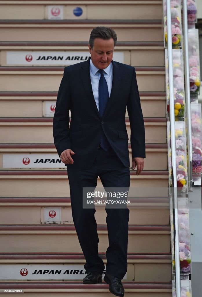 Britain's Prime Minister David Cameron disembarks upon arrival at Chubu Centrair International Airport in Nagoya on May 25, 2016 ahead of the 2016 Ise-Shima G7 Summit. World leaders began gathering in Japan on May 25 ahead of a Group of Seven summit set to be dominated by the lacklustre global economy. / AFP / MANAN