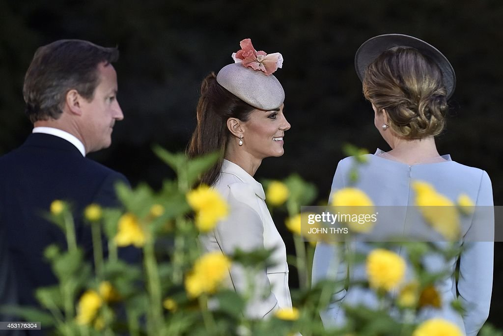 Britain's Prime minister David Cameron, Duchess of Cambridge Catherine and Belgian Queen Mathilde speak as they attend a ceremony at the Saint Symphorien Military cemetery on August 4, 2014 in Mons, Belgium, during commemorations marking 100 years since the invasion of Belgium by Germany at the start of World War I. World leaders on August 4 commemorated the 100th anniversary of the outbreak of World War I, a small Balkans conflict that went global with the German invasion of neutral Belgium in August 1914. AFP PHOTO / JOHN THYS