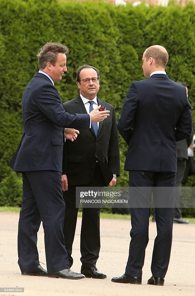 Britain's Prime Minister David Cameron, French President Francois Hollande and Britain's Prince William discuss as they attend on July 1, 2016 a ceremony marking the 100th anniversary of the World War I battle at the River Somme at the Thiepval Memorial. Under grey skies, unlike the clear sunny day that saw the biggest slaughter in British military history a century ago, the commemoration kicked off at the deep Lochnagar crater, created by the blast of mines placed under German positions two minutes before the attack began at 7:30 am on July 1, 1916. / AFP / FRANCOIS