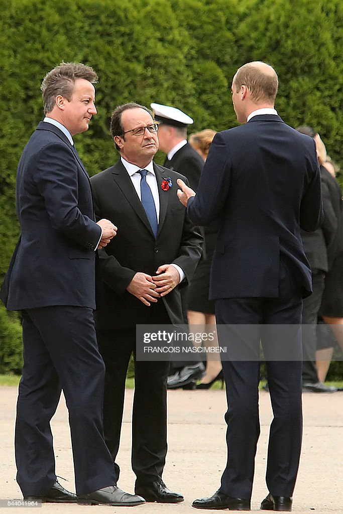 Britain's Prime Minister David Cameron, French President Francois Hollande and Britain's Prince William discuss as they attend on July 1, 2016 a ceremony marking the 100th anniversary of the World War I battle at the River Somme at the Thiepval Memorial, northern France. Under grey skies, unlike the clear sunny day that saw the biggest slaughter in British military history a century ago, the commemoration kicked off at the deep Lochnagar crater, created by the blast of mines placed under German positions two minutes before the attack began at 7:30 am on July 1, 1916. / AFP / FRANCOIS