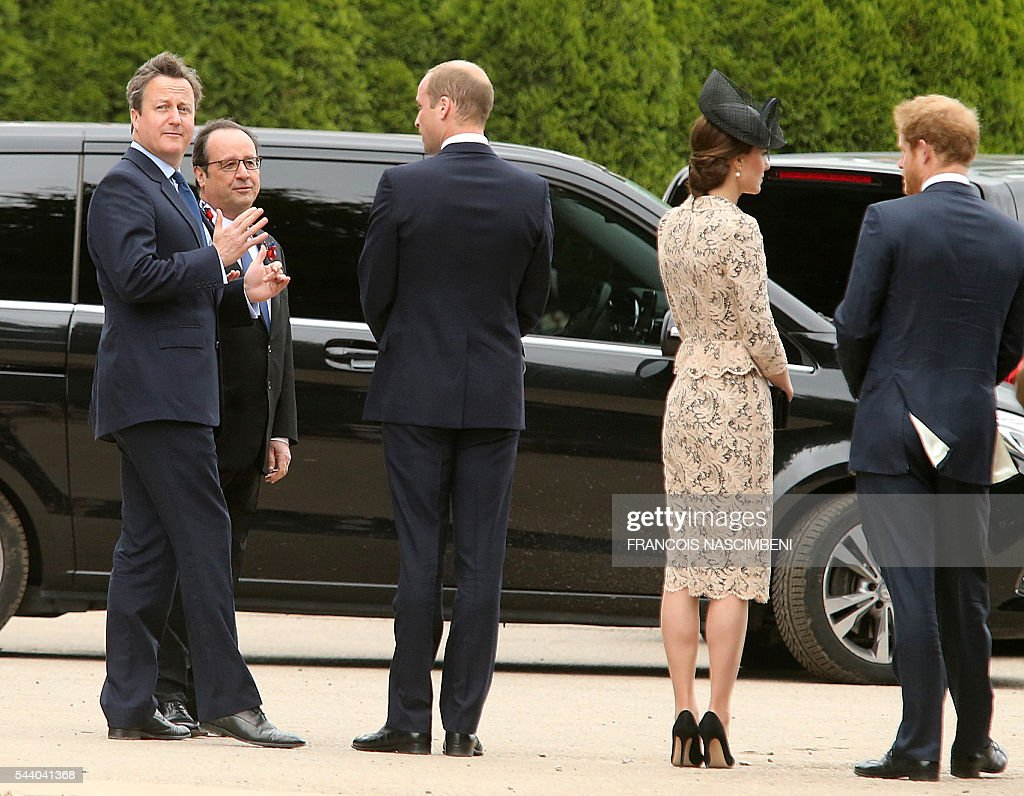 Britain's Prime Minister David Cameron, French President Francois Hollande, Britain's Prince William, Britain's Princess Catherine and Britain's Prince harry discuss as they attend on July 1, 2016 a ceremony marking the 100th anniversary of the World War I battle at the River Somme at the Thiepval Memorial, northern France. Under grey skies, unlike the clear sunny day that saw the biggest slaughter in British military history a century ago, the commemoration kicked off at the deep Lochnagar crater, created by the blast of mines placed under German positions two minutes before the attack began at 7:30 am on July 1, 1916. / AFP / FRANCOIS
