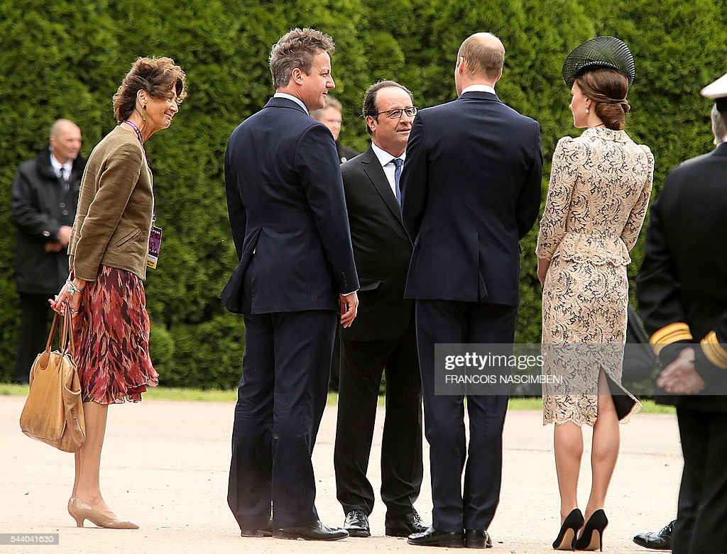 Britain's Prime Minister David Cameron, French President Francois Hollande, Britain's Prince William and his wife Britain's Princess Catherine discuss as they attend on July 1, 2016 a ceremony marking the 100th anniversary of the World War I battle at the River Somme at the Thiepval Memorial. Under grey skies, unlike the clear sunny day that saw the biggest slaughter in British military history a century ago, the commemoration kicked off at the deep Lochnagar crater, created by the blast of mines placed under German positions two minutes before the attack began at 7:30 am on July 1, 1916. / AFP / FRANCOIS