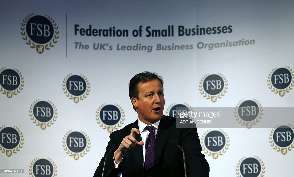 Britain's Prime Minister David Cameron gestures while speaking to the Federation of Small Business in London on January 27, 2014. Cameron pledged to cut red tape to save money for small businesses in a speech to the Federation's national event in London.