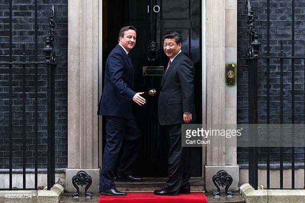 Britain's Prime Minister David Cameron greets China's president Xi Jinping as he arrives in Downing Street on October 21 2015 in London England The...