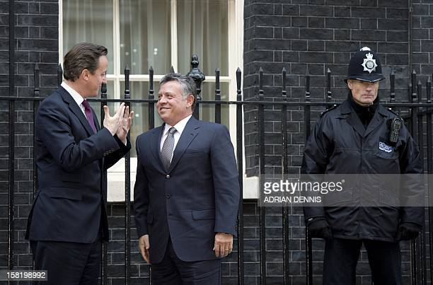 Britain's Prime Minister David Cameron greets King Abdullah II of Jordan outside No 10 Downing Street in London on December 11 2012 AFP PHOTO /...