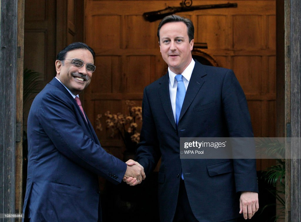 Britain's Prime Minister <a gi-track='captionPersonalityLinkClicked' href=/galleries/search?phrase=David+Cameron+-+Politician&family=editorial&specificpeople=227076 ng-click='$event.stopPropagation()'>David Cameron</a>, greets Pakistan's President <a gi-track='captionPersonalityLinkClicked' href=/galleries/search?phrase=Asif+Ali+Zardari&family=editorial&specificpeople=1125723 ng-click='$event.stopPropagation()'>Asif Ali Zardari</a> as they meet on August 5, 2010 at Chequers near Princes Risborough in England. President Zardari has come under fire for his diplomatic visit to the UK whilst over 1,100 people have been killed by devastating floods in his country.