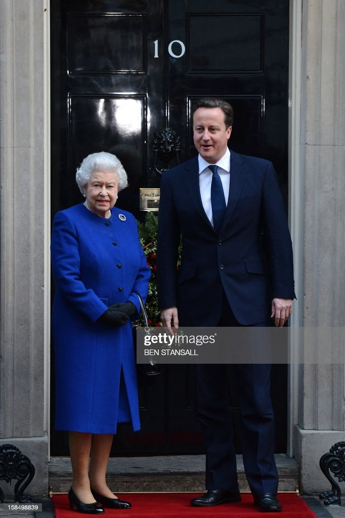 Britain's Prime Minister David Cameron (R) greets Queen Elizabeth II (L) outside No 10 Downing Street in London December 18, 2012 as she arrives to attend a meeting of the Cabinet. Queen Elizabeth II attended her first-ever cabinet meeting on Tuesday to mark her diamond jubilee, the only monarch to do so since 1781.The 86-year-old sovereign sat in as an observer on the meeting and received a gift from the Cabinet to celebrate her 60 years on the throne.