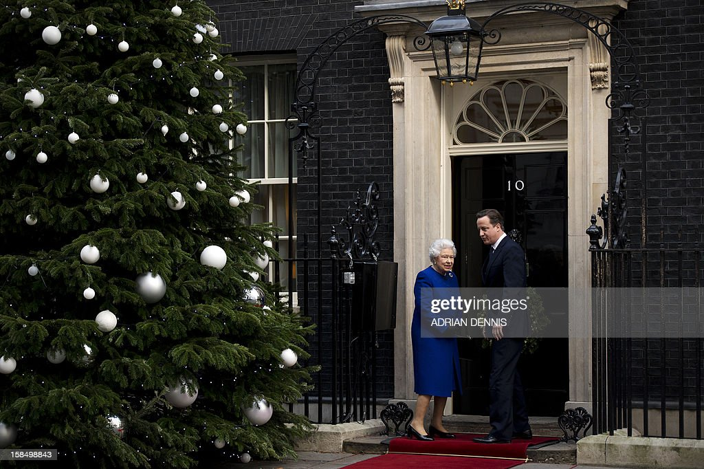 Britain's Prime Minister David Cameron (R) greets Queen Elizabeth II (L) outside No 10 Downing Street in London December 18, 2012 as she arrives to attend the meeting of the Cabinet. Queen Elizabeth II attended her first-ever cabinet meeting on Tuesday to mark her diamond jubilee, the only monarch to do so since 1781.The 86-year-old sovereign sat in as an observer on the meeting and received a gift from the Cabinet to celebrate her 60 years on the throne.