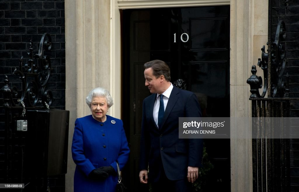Britain's Prime Minister David Cameron (R) greets Queen Elizabeth II (L) outside No 10 Downing Street in London December 18, 2012 as she arrives to attend the meeting of the Cabinet. Queen Elizabeth II attended her first-ever cabinet meeting on Tuesday to mark her diamond jubilee, the only monarch to do so since 1781.The 86-year-old sovereign sat in as an observer on the meeting and received a gift from the Cabinet to celebrate her 60 years on the throne. AFP PHOTO / ADRIAN DENNIS