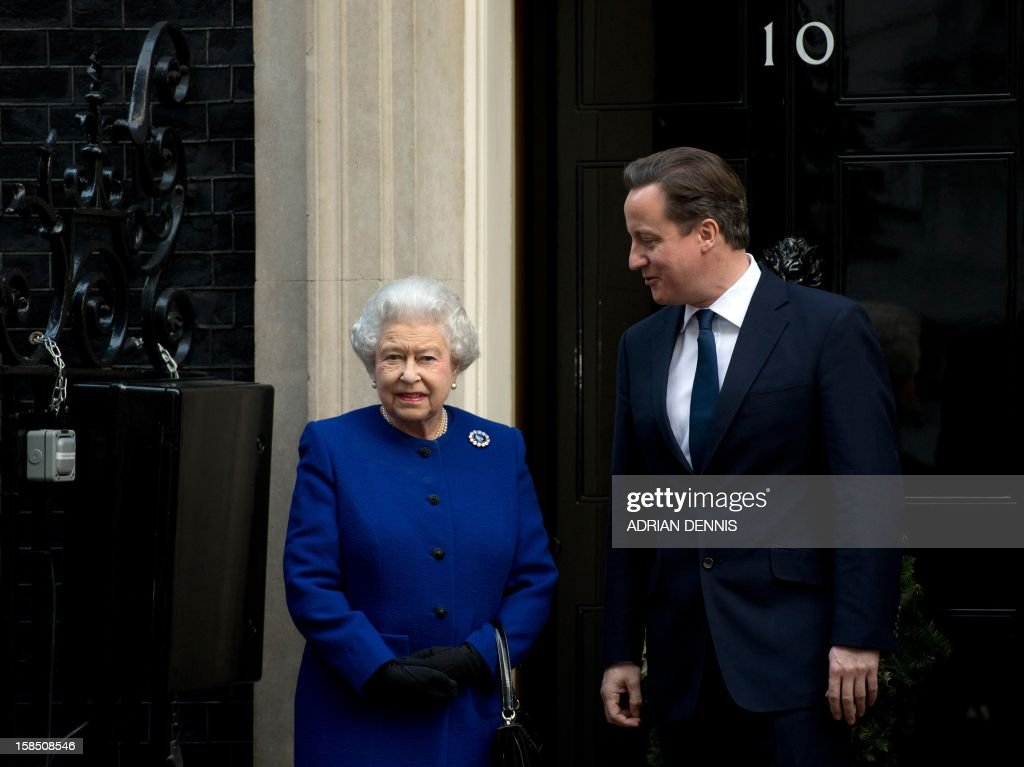 Britain's Prime Minister David Cameron (R) greets Queen Elizabeth II (L) outside No 10 Downing Street in London December 18, 2012 as she arrives to attend a meeting of the Cabinet. Queen Elizabeth II attended her first-ever cabinet meeting on Tuesday to mark her diamond jubilee, the only monarch to do so since 1781.The 86-year-old sovereign sat in as an observer on the meeting and received a gift from the Cabinet to celebrate her 60 years on the throne. AFP PHOTO / ADRIAN DENNIS