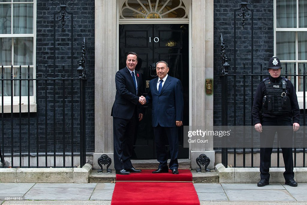 Britain's Prime Minister David Cameron (L) greets the President of Kazakstan, Nursultan Nazarbayev, at Downing Street on November 3, 2015 in London, England. Mr Nazarbayev is in the United Kingdom on a three-day visit.